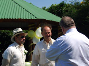 David talks over last minute details with the groom and best man